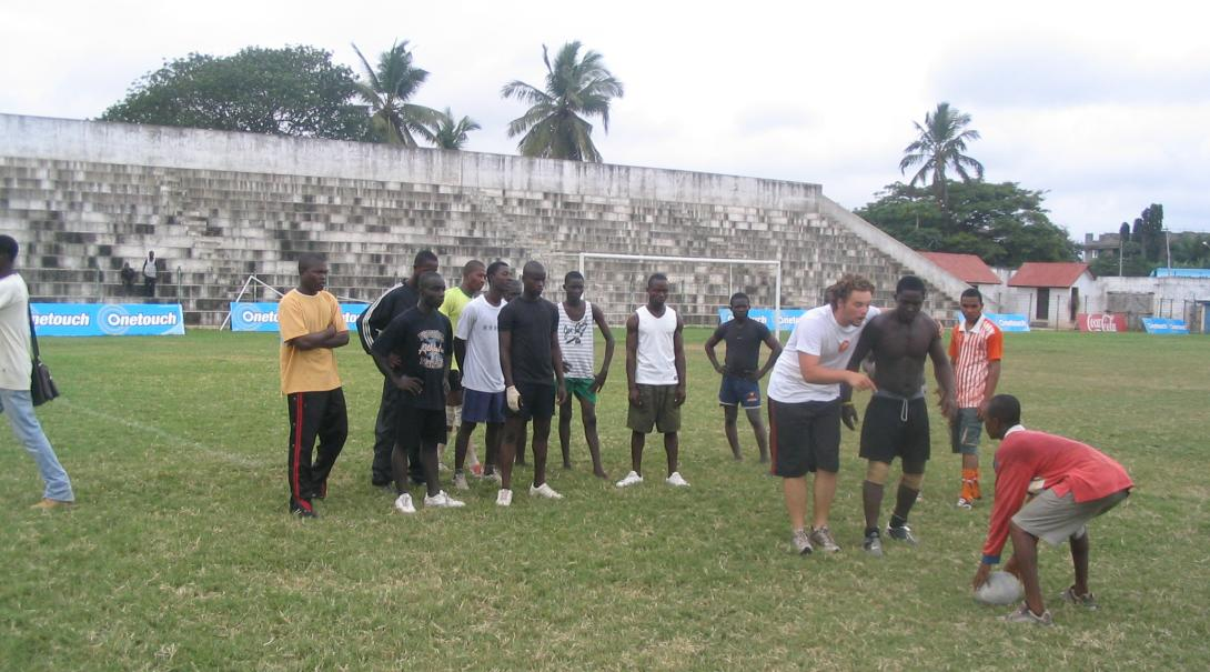 A Projects Abroad rugby volunteer explains some techniques to local players in Ghana during his internship.